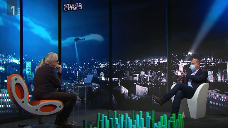 Jože P. Damijan explaining his plan for platform on Studio City programme. Pictured is also host Marcel Štefančič, jr.